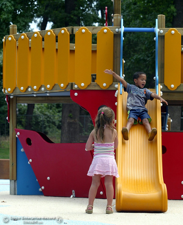 . Sophia Vagts, 4 (bottom) watches David Stillwell, 4 (top), slide off the ship as kids play at the Nico Cardoza Memorial Park at Caper Acres in this file photo from July 2007. (Jason Halley/Chico Enterprise-Record)