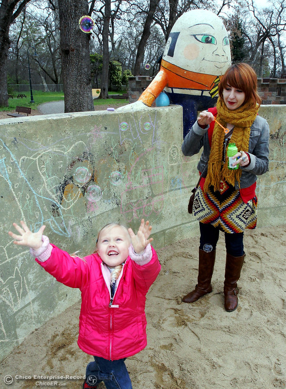 . Lucy Struthers, 4, of Chico was trying to catch some flying bubbles blown by her aunt, Amanda Barron as they played in the sandbox at Caper Acres in this file photo from March 2012. (Ty Barbour/Chico Enterprise-Record)