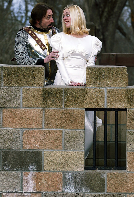 ". Jeff Dickenson, playing King Arthur, and Allison Rich, playing Guinevere, rehearse a scene in Chico Theater Company\'s upcoming production of ""Camelot\""  at Caper Acres in this file photo from March 2004. (Glenn Fuentes/Chico Enterprise-Record file photo)"