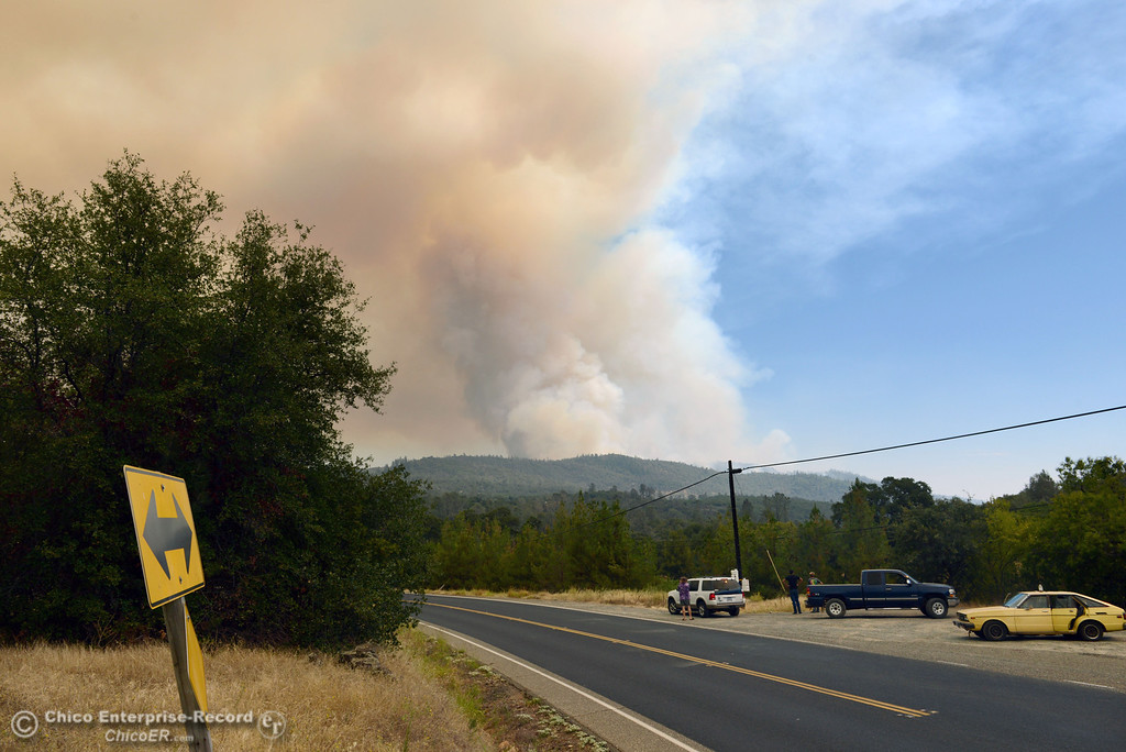. People watch the smoke from the Swedes Fire along Forbestown Road and Old Olive Highway as mandatory evacuation areas around the Swedes Fire southeast of Oroville were expanded just after noon Saturday, August 17, 2013 in Oroville, Calif.  (Jason Halley/Chico Enterprise-Record)