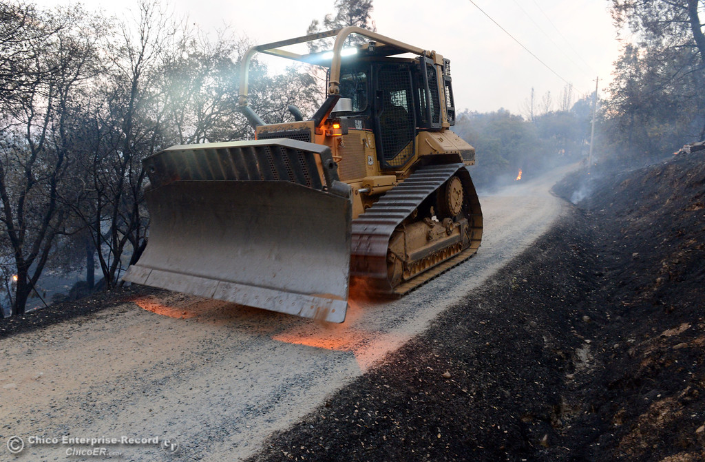 . A dozer drives toward the Swedes Fire that burned along Chinese Wall Road in the vicinity of Swedes Flat Road, just east or Oro Bangor Highway Friday, August 16, 2013 in Oroville, Calif. Over 200 acres were burned with at least one structure lost. (Jason Halley/Chico Enterprise-Record)