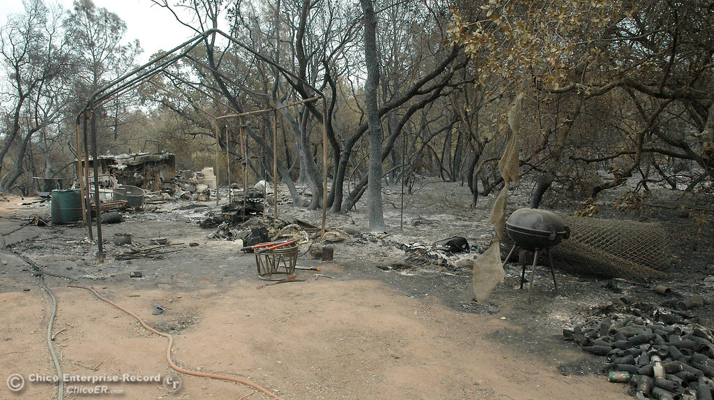 . The charred remains at a residence on Chinese Wall Road on Monday evidence the raging wildland fire that swept through the Swedes Flat Road area over the weekend. Swedes Fire Monday, Aug. 19, 2013.  (Barbara Arrigoni/Staff Photo)