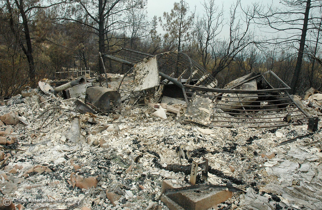 . At the top of concrete steps and a walkway, the ruined remains of a residence sit in an ashen pile Monday on Chinese Wall Road. The structure burned Friday in the Swedes fire. Swedes Fire Monday, Aug. 19, 2013, near Bangor, CA.  (Barbara Arrigoni/Staff Photo)