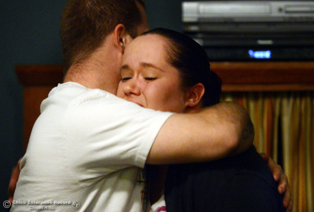 . Jacob Maier (left) embraces Jessica DePriest, after she was overcome with emotion sharing her story to people who came out for the 6th Street Center for Youth open house, art show and poetry reading in recognition of Runaway and Homeless Youth Month Thursday, November 14, 2013 in Chico, Calif.  (Jason Halley/Chico Enterprise-Record)