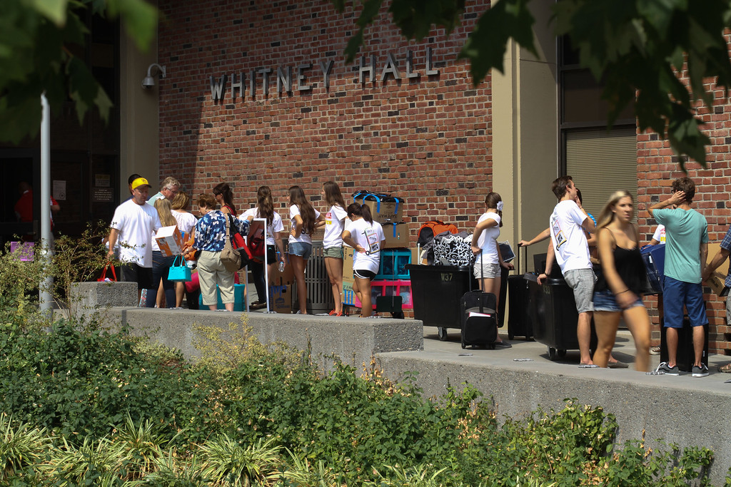 . Incoming freshman and their families wait for use of the elevators to move their things into their new room in Whitney Hall at Chico State on Tuesday, August 20, 2013. (Frank Rebelo/Staff Photo)