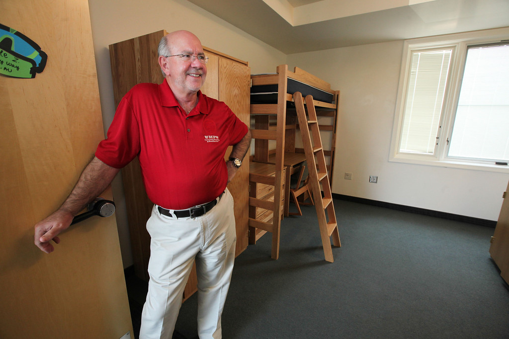 . David Stephen, Director of University Housing and Food Service shows an empty room in Sutter Hall yet to be moved into by Incoming freshman on Tuesday, August 20, 2013. (Frank Rebelo/Staff Photo)