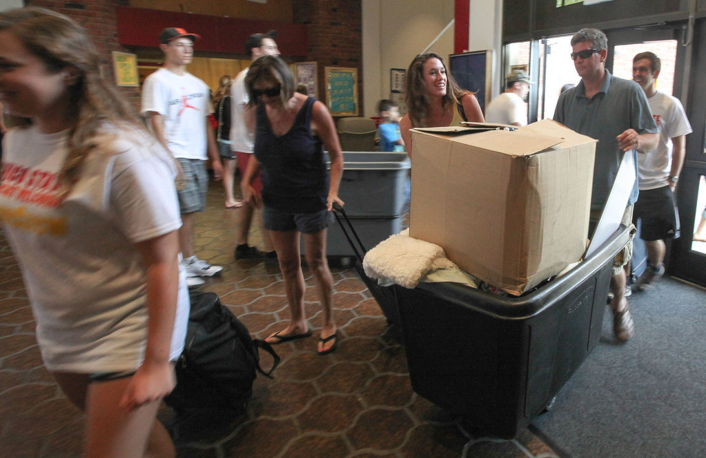 . Incoming freshman Nicole Pintarelli and her family prepare move her things into her new room in Whitney Hall at Chico State on Tuesday, August 20, 2013. (Frank Rebelo/Staff Photo)