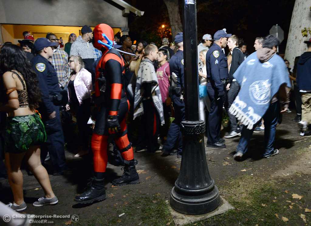 . Chico Police patrol the through the streets of downtown and south Chico State campus area for Halloween Thursday, October 31, 2013 in Chico, Calif.  (Jason Halley/Chico Enterprise-Record)