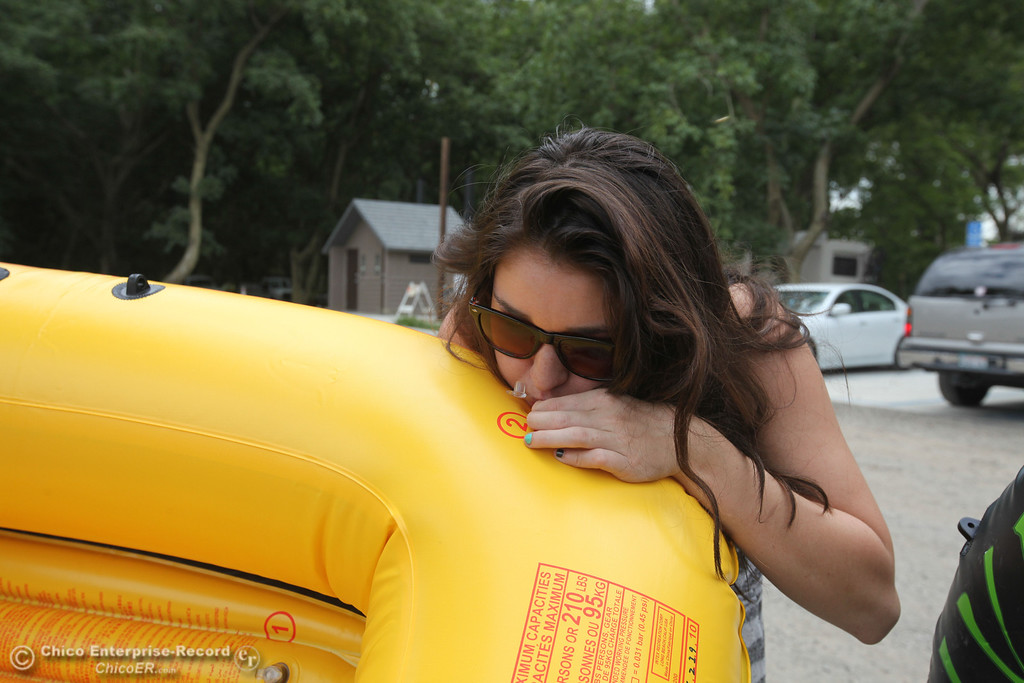 . Maddie Mayoral, a Chico State student, finishes blowing up her raft before heading out on the Sacramento River for the Labor Day weekend float on Sunday, September 1, 2013. (Frank Rebelo/Staff Photo)