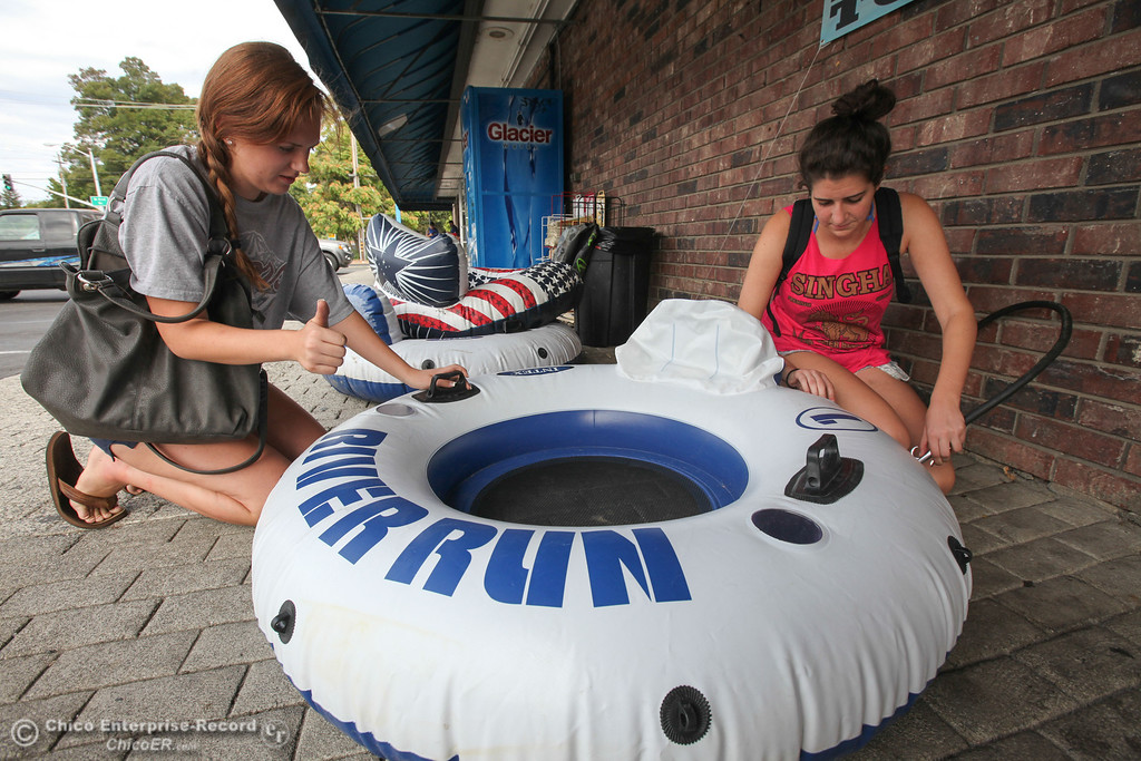 . Adrien Rubsey and Danielle Reff fill up their tubes at Ray\'s Liquour before partaking in the Labor Day weekend float down the Sacramento River on Sunday, September 1, 2013. (Frank Rebelo/Staff Photo)