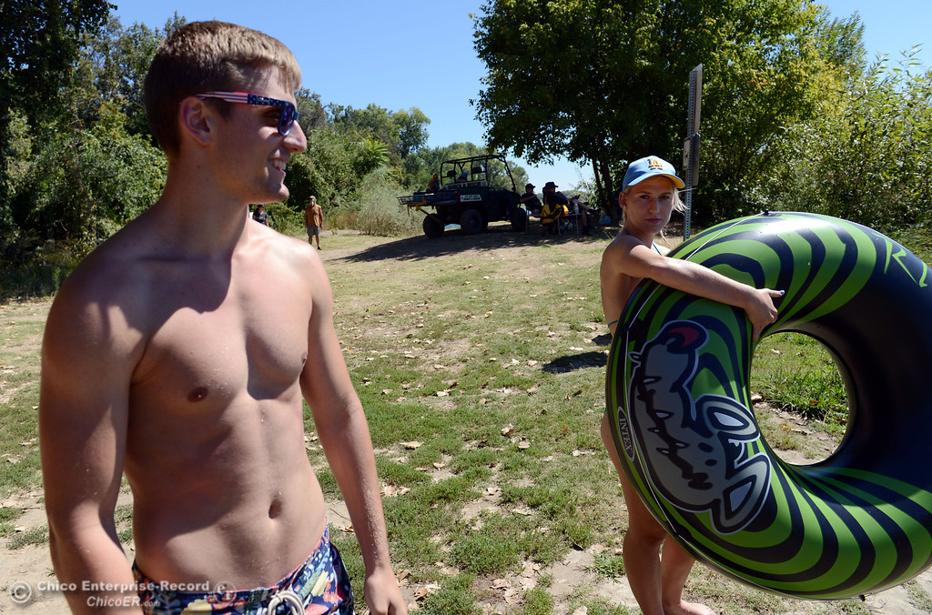 . UCLA student Kelsey Vanderschoot (right) and Chico State student Dan Kelham, 20 (left) were two of the very few amount of people that came out to float on the Sacramento River, which authorities were enforcing an alcohol ban as part of Labor Day weekend Saturday, August 31, 2013 in Hamilton City, Calif.  (Jason Halley/Chico Enterprise-Record)