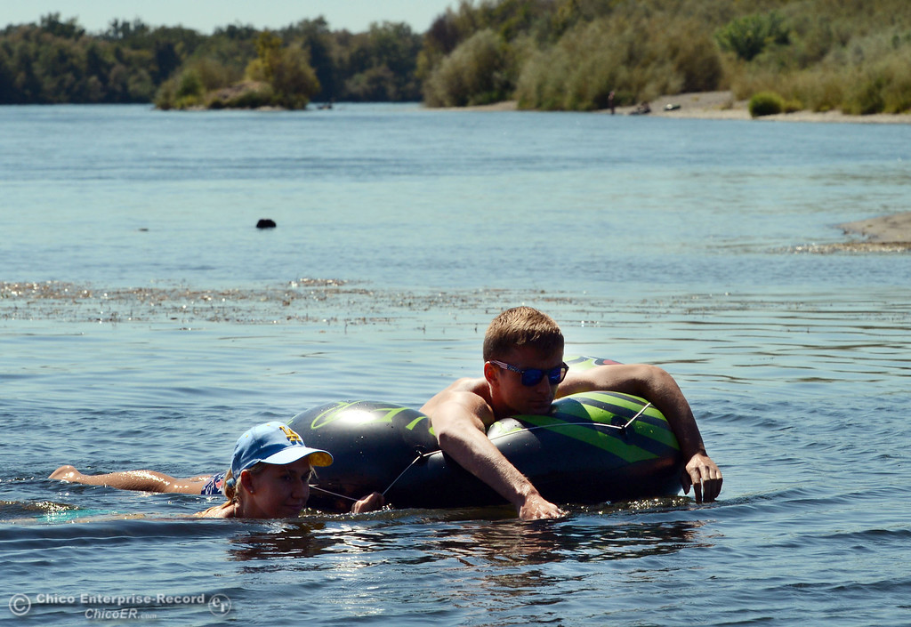 . UCLA student Kelsey Vanderschoot (left) and Chico State student Dan Kelham, 20 (right) were two of the very few amount of people that came out to float on the Sacramento River, which authorities were enforcing an alcohol ban as part of Labor Day weekend Saturday, August 31, 2013 in Hamilton City, Calif.  (Jason Halley/Chico Enterprise-Record)