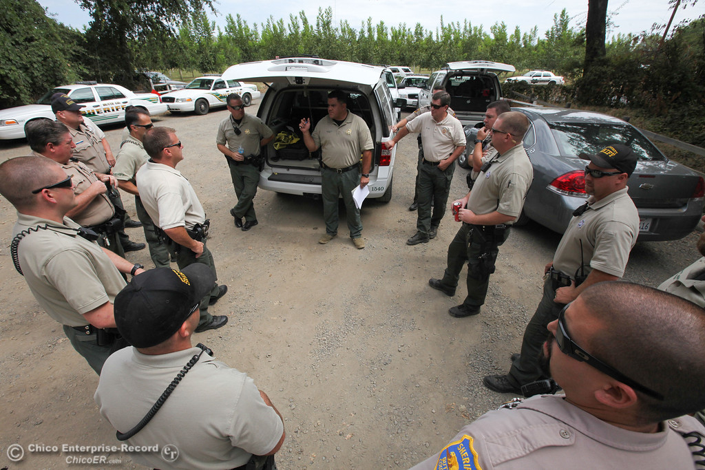 . Sergeant Derek Bell (center) leads a Butte County Sheriff briefing for the Labor Day weekend float on Sunday, September 1, 2013. (Frank Rebelo/Staff Photo)