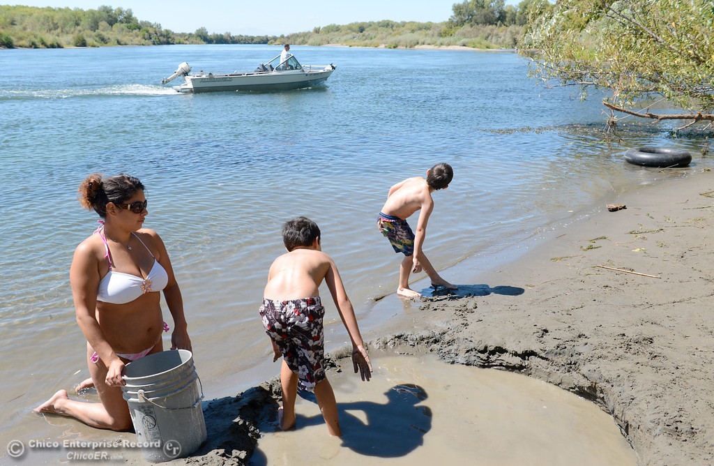 . Bethany Torres of Chico and her sons Andrew Stover 9, and Aden Stover 7, enjoy the Sacramento River near Pine Creek and Scotty\'s Boat Landing on Labor Day Monday, Sept. 2, 2013. Torres said she had recently moved here from the Seattle Wash. area and they were just out enjoying the river Monday. (Bill Husa/Staff Photo)