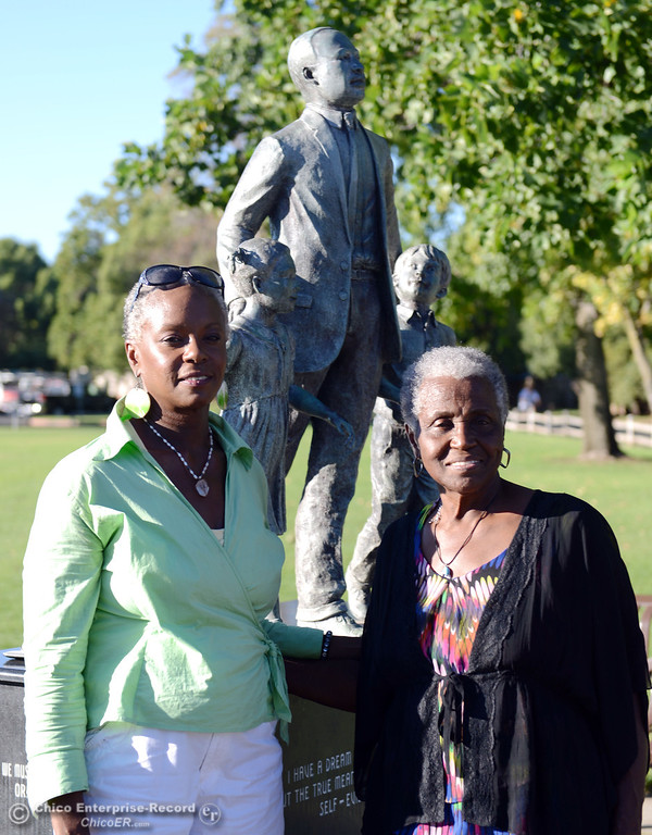 . Aneeia Johnson (left) and Dorothy Johnson (right) have their picture taken in front of the Martin Luther King Jr statue as the community came out to remember the 50th Anniversary of the Martin Luther King Jr. March on Washington by marching from the Dorothy Johnson Center to Community Park on Wednesday, August 28, 2013 in Chico, Calif.  (Jason Halley/Chico Enterprise-Record)