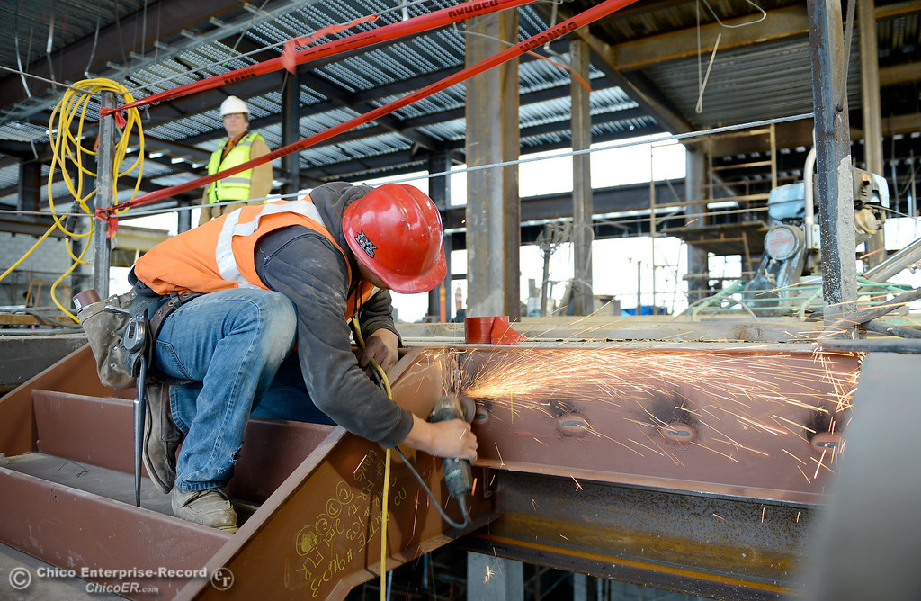 . Juan Rosas uses a grinder on an area by a stairwell during construction of the new North Butte County Courthouse located off of Bruce Road at 1701 Concord Ave. in Chico, Calif. Wednesday Jan. 29, 2014.  (Bill Husa/Staff Photo)