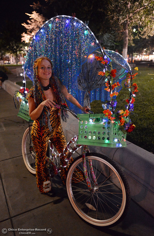. Kelly Mosenfelder created a colorful light bike for burning man that she test rode around downtown Chico Friday, August 23, 2013 in Chico, Calif.  (Jason Halley/Chico Enterprise-Record)