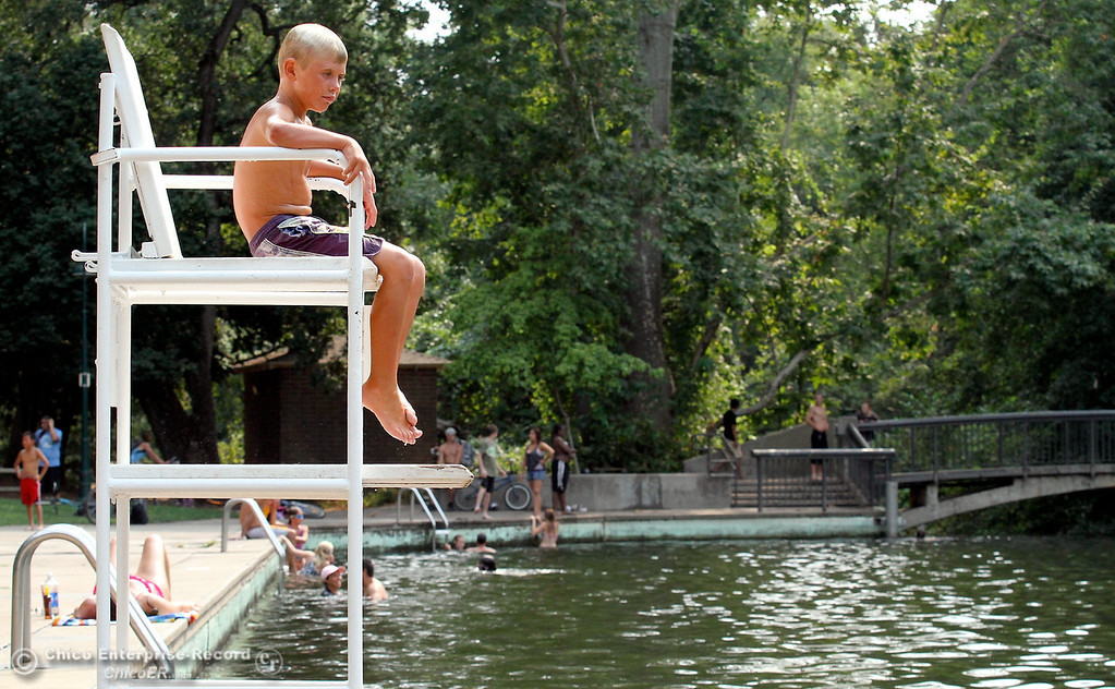 . John Holly, 8, of Paradise, checks out the view from the lifeguard stand at Sycamore Pool at One Mile Recreation Area of lower Bidwell Park on August 14, 2012. (Bill Husa/Chico Enterprise-Record)