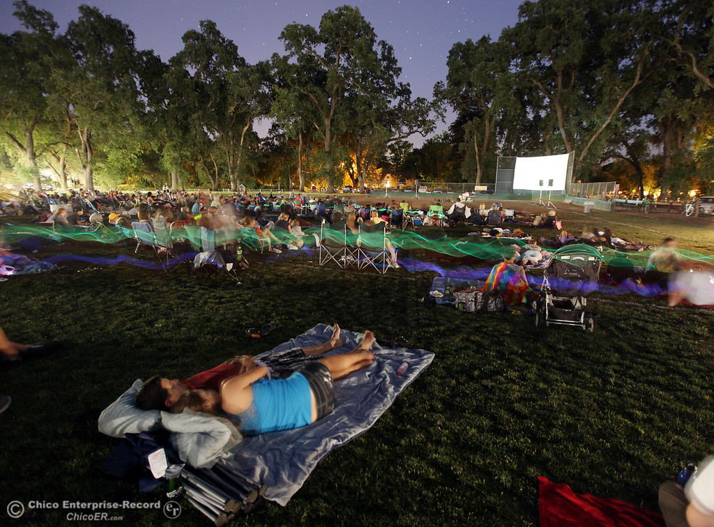 """. Matt Meyers and Lareesa Myers (bottom) relax under moonlight to watch \""""The Odd Life of Timothy Green\"""" that was shown on the big screen at Sycamore Field at the One-Mile Recreation Area in lower Bidwell Park, as a treat put on by the Chico Area Recreation and Park District on June 15, 2013 in Chico, Calif.  (Jason Halley/Chico Enterprise-Record)"""