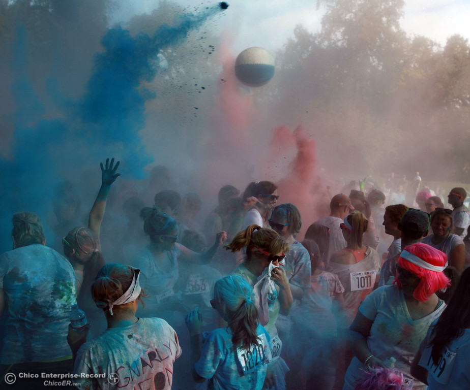 . A storm of colored powder is cast over runners after they finished the Gnarly Neon 5K run at One Mile Recreation Area in lower Bidwell Park on November 3, 2012 in Chico, Calif. (Jason Halley /Chico Enterprise-Record)