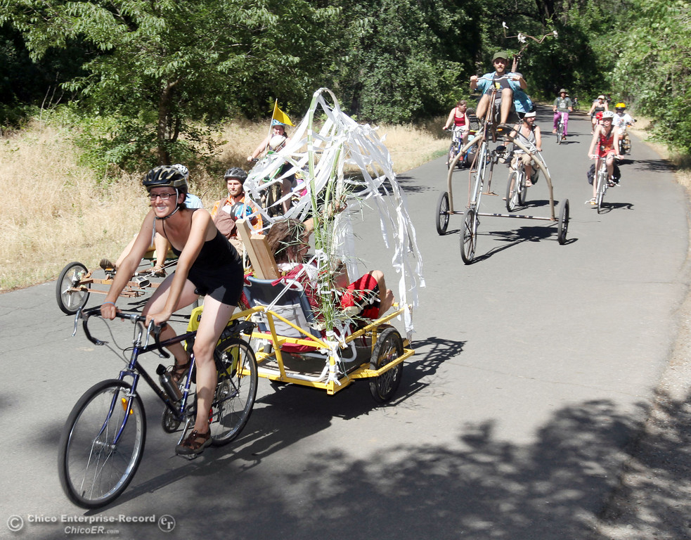 . A group of bicyclists ride through lower Bidwell Park listening to music for a bike parade during Chico Bike Music Festival on June 1, 2013 in Chico, Calif. (Jason Halley/Chico Enteprise-Record)