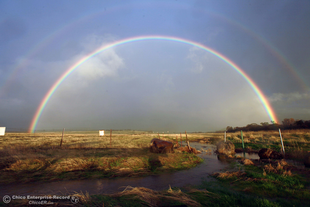 . A double rainbow reaches across the sky over the entrance of upper Bidwell Park on November 30, 2012 in Chico, Calif.  (Jason Halley/Enterprise-Record)