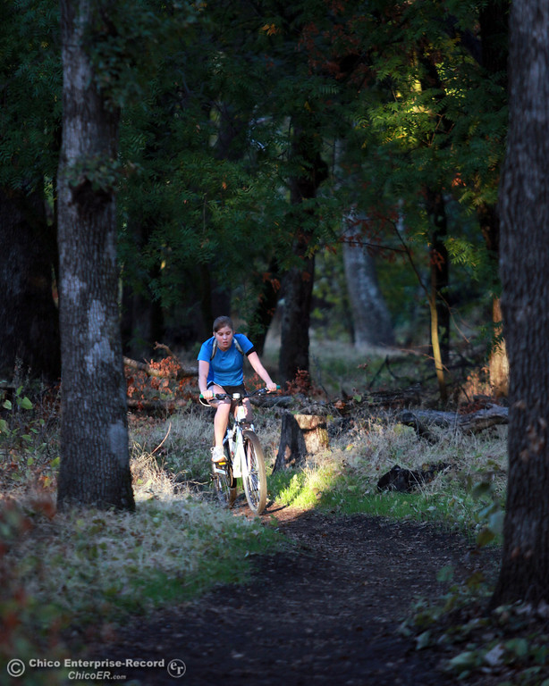 . A bicyclist rides along the trail in lower Bidwell Park on November 1, 2012 in Chico, Calif. (Jason Halley /Chico Enterprise-Record)