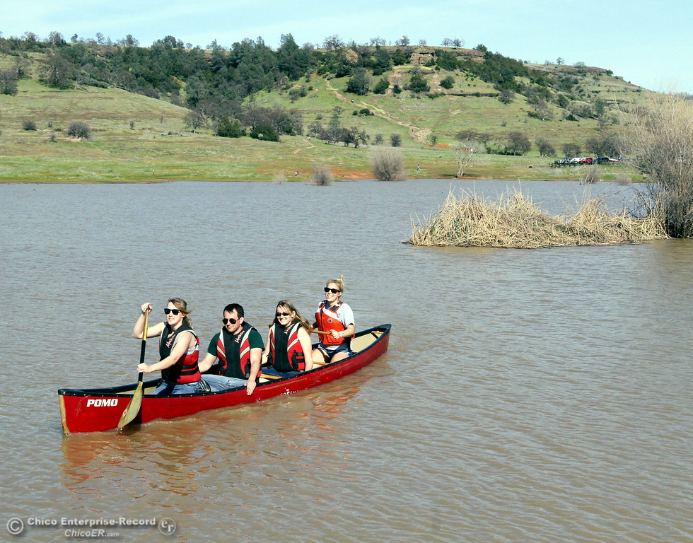 . The Chico State Civil Engeenering Concrete Canoe Team engineering students Katherine Wade, Bryan Moore, Katelyn Warner and Meghan Heise (left to right) work on paddling practice at Horseshoe Lake in upper Bidwell Park in a regular canoe while their cement canoe was back at the college under construction on March 10, 2013. They have a big match with 8 other colleges in San Jose on April 19th and they need all the practice they can get. In the canoe are front to back . (Ty Barbour/Staff Photo)