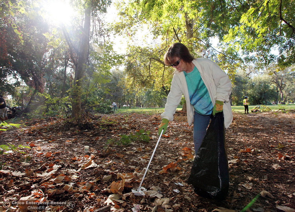 ". Lynn Sacks picks up garbage as people volunteer their time and effort for ""Make a Difference Day\"" cleaning up One Mile Recreation Area in lower Bidwell Park on October 27, 2012 in Chico, Calif. (Jason Halley /Chico Enterprise-Record)"