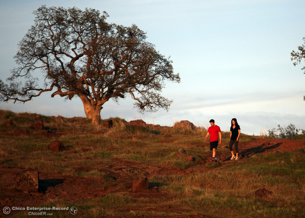 . The sun sets on people hiking in upper Bidwell Park on March 13, 2013 in Chico, Calif. (Jason Halley/Chico Enterprise-Record)