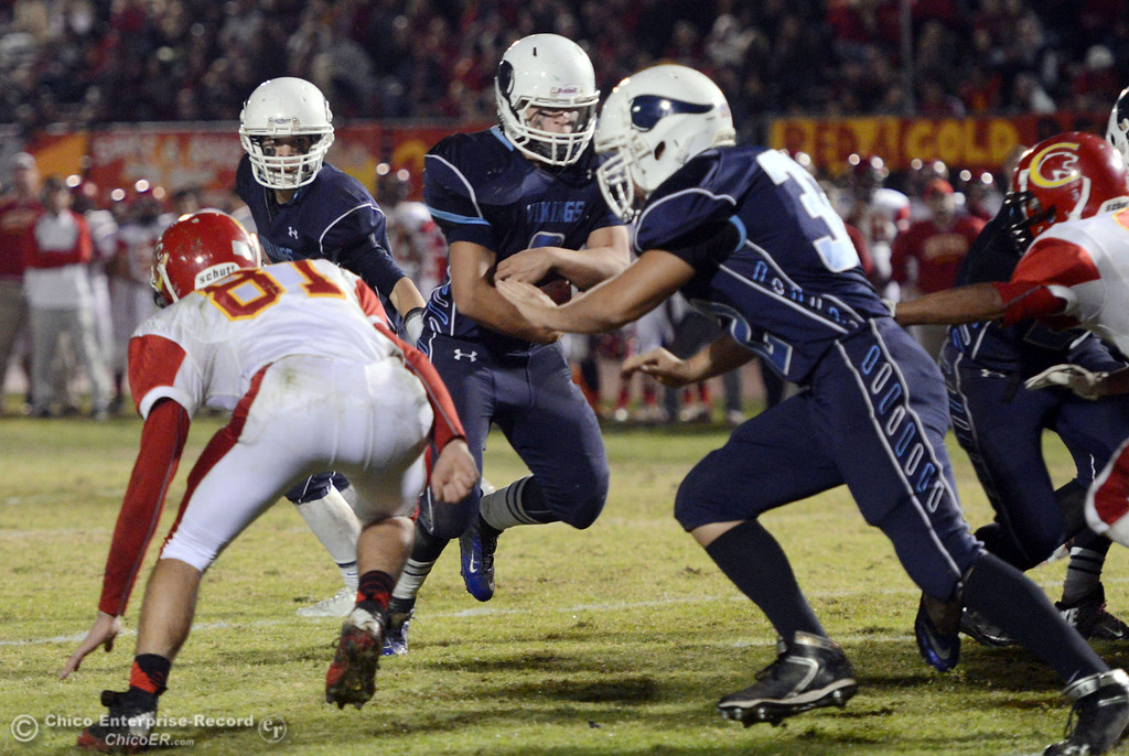 . Pleasant Valley High\'s #9 Houston McGowan (center) rushes against Chico High in the third quarter of their Almond Bowl football game at CSUC University Stadium Friday, November 1, 2013 in Chico, Calif.  (Jason Halley/Chico Enterprise-Record)
