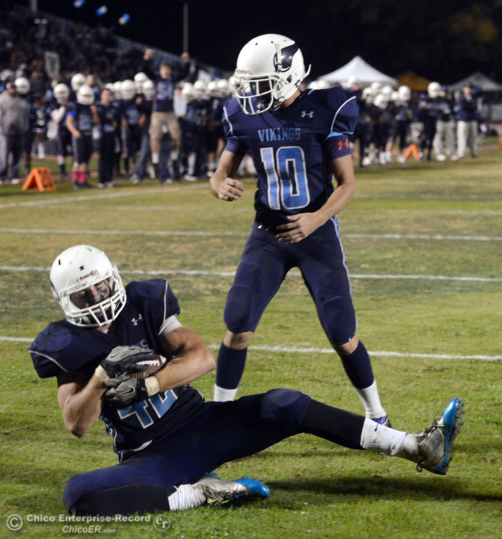. Pleasant Valley High\'s #10 Tucker LaRue (right) watches #42 Chad Olsen catch for a touchdown against Chico High  in the third quarter of their Almond Bowl football game at CSUC University Stadium Friday, November 1, 2013 in Chico, Calif.  (Jason Halley/Chico Enterprise-Record)