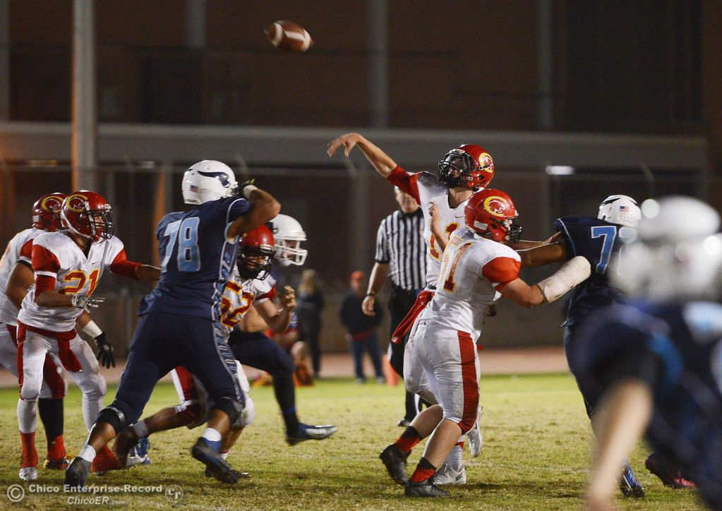 . Chico High\'s #11 Clayton Welch throws a pass against Pleasant Valley High in the second quarter of their Almond Bowl football game at CSUC University Stadium Friday, November 1, 2013 in Chico, Calif.  (Jason Halley/Chico Enterprise-Record)