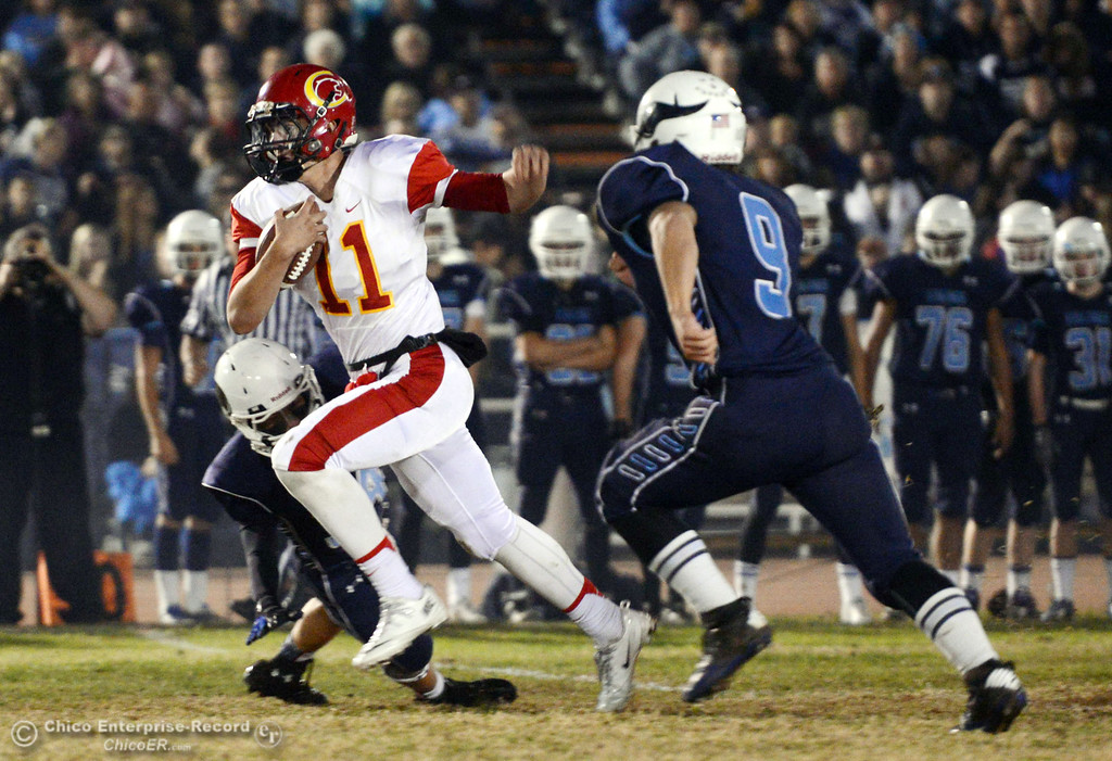 . Chico High\'s #11 Clayton Welch (center) is tackled against Pleasant Valley High\'s #34 Cale Crawford (left) and #9 Houston McGowan (right) in the first quarter of their Almond Bowl football game at CSUC University Stadium Friday, November 1, 2013 in Chico, Calif.  (Jason Halley/Chico Enterprise-Record)