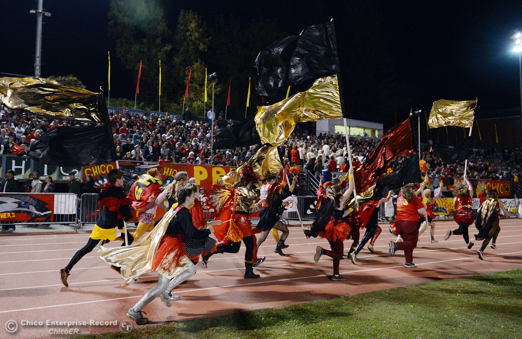 . Chico High fans run the track to cheer on against Pleasant Valley High in the first quarter of their Almond Bowl football game at CSUC University Stadium Friday, November 1, 2013 in Chico, Calif.  (Jason Halley/Chico Enterprise-Record)