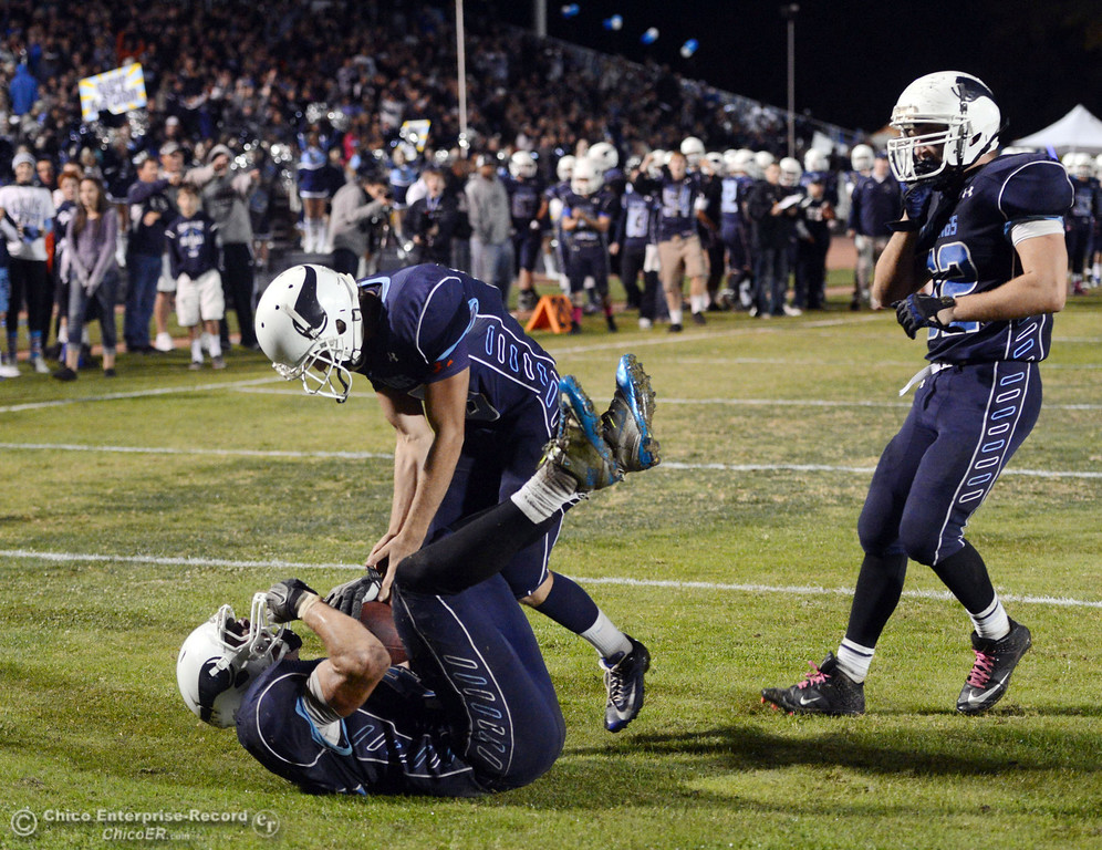 . Pleasant Valley High\'s #42 Chad Olsen (left) catches for a touchdown as #10 Tucker LaRue (center) and #52 Riley Andrew (right) celebrate against Chico High  in the third quarter of their Almond Bowl football game at CSUC University Stadium Friday, November 1, 2013 in Chico, Calif.  (Jason Halley/Chico Enterprise-Record)