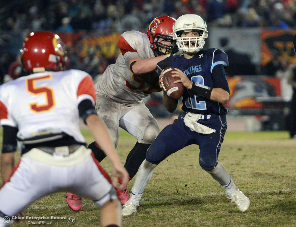 . Chico High\'s #58 Malik Hopkins (left) sacks Pleasant Valley High\'s #12 Trent Darms (right) in the third quarter of their Almond Bowl football game at CSUC University Stadium Friday, November 1, 2013 in Chico, Calif.  (Jason Halley/Chico Enterprise-Record)