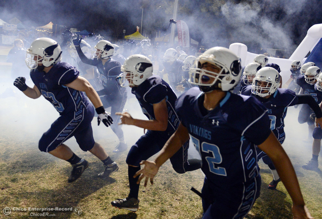 . Pleasant Valley High takes the field against Chico High in the first quarter of their Almond Bowl football game at CSUC University Stadium Friday, November 1, 2013 in Chico, Calif.  (Jason Halley/Chico Enterprise-Record)