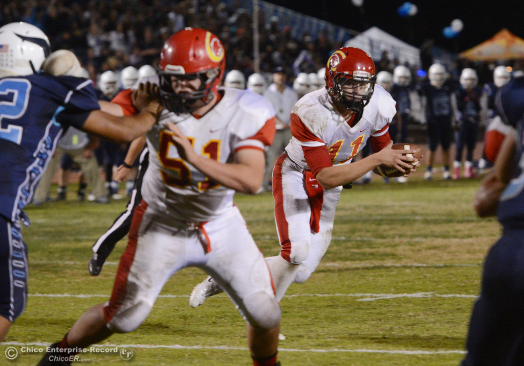 . Chico High\'s #11 Clayton Welch runs the ball against Pleasant Valley High in the first quarter of their Almond Bowl football game at CSUC University Stadium Friday, November 1, 2013 in Chico, Calif.  (Jason Halley/Chico Enterprise-Record)