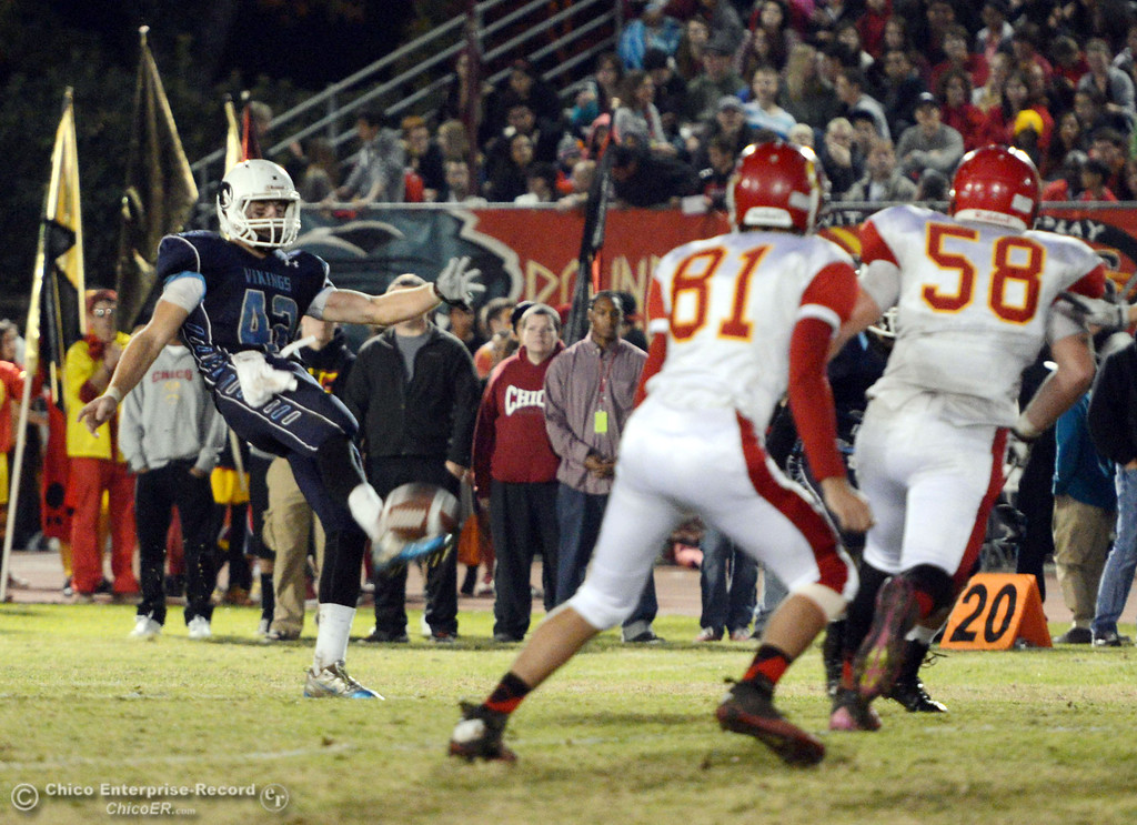. Pleasant Valley High\'s #42 Chad Olsen punts away against Chico High in the second quarter of their Almond Bowl football game at CSUC University Stadium Friday, November 1, 2013 in Chico, Calif.  (Jason Halley/Chico Enterprise-Record)