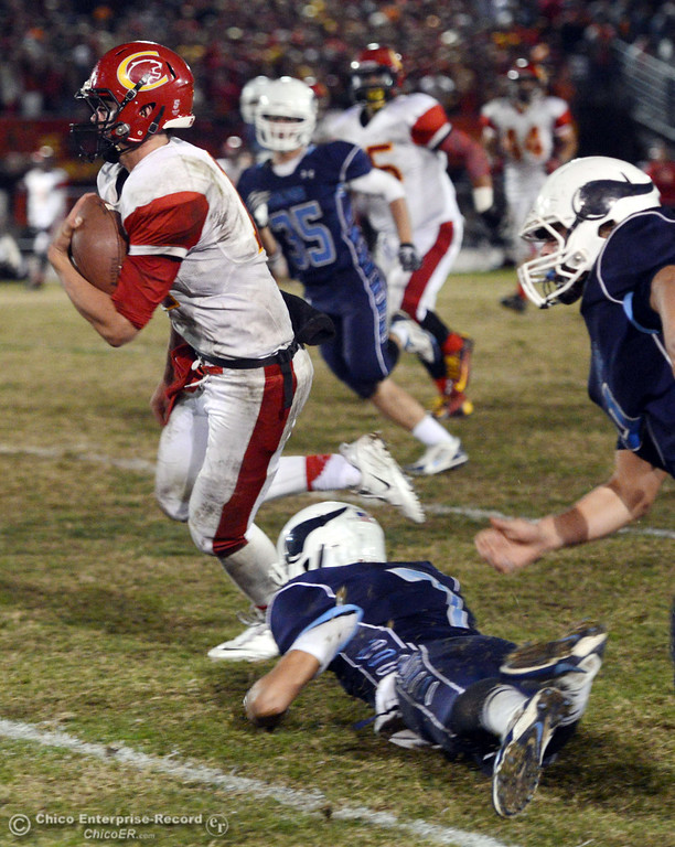 . Chico High\'s #11 Clayton Welch (left) runs for a touchdown against Pleasant Valley High in the third quarter of their Almond Bowl football game at CSUC University Stadium Friday, November 1, 2013 in Chico, Calif.  (Jason Halley/Chico Enterprise-Record)