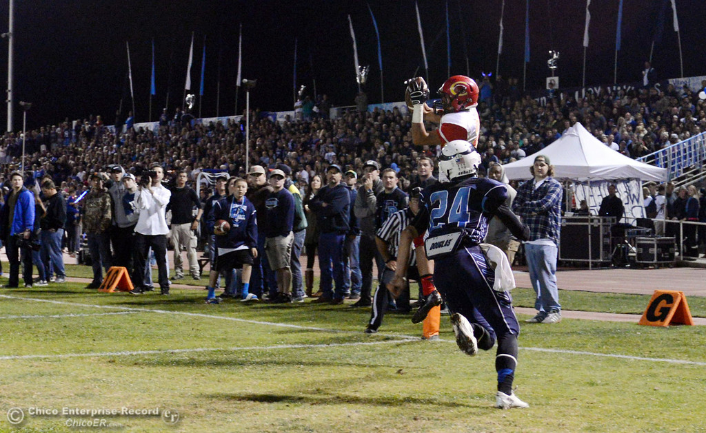 . Chico High\'s #27 Noah Collado (back) catches for a touchdown against Pleasant Valley High\'s #24 Jack Soza (front) in the second quarter of their Almond Bowl football game at CSUC University Stadium Friday, November 1, 2013 in Chico, Calif.  (Jason Halley/Chico Enterprise-Record)