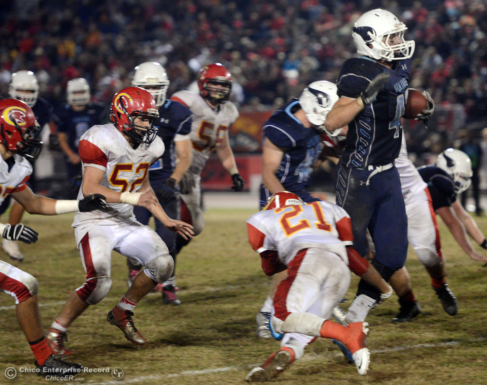 . Chico High\'s #21 Cameron Alfaro (left) tackles Pleasant Valley High\'s #42 Chad Olsen (right) in the third quarter of their Almond Bowl football game at CSUC University Stadium Friday, November 1, 2013 in Chico, Calif.  (Jason Halley/Chico Enterprise-Record)