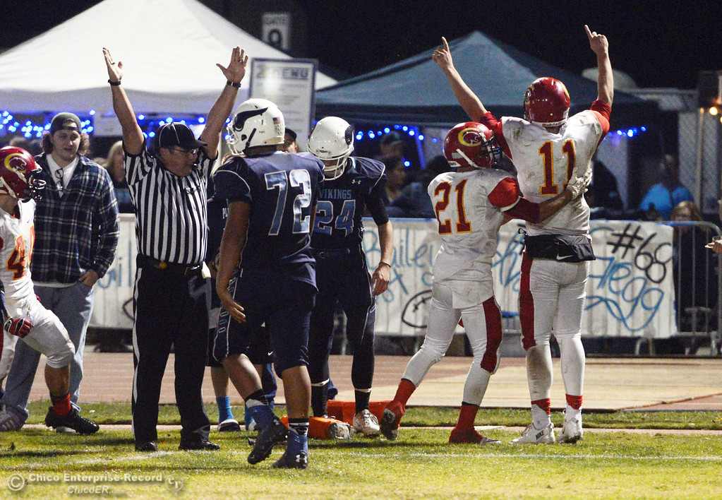 . Chico High\'s #21 Cameron Alfaro (left) congratulates #11 Clayton Welch (right) on scoring a touchdown against Pleasant Valley High in the second quarter of their Almond Bowl football game at CSUC University Stadium Friday, November 1, 2013 in Chico, Calif.  (Jason Halley/Chico Enterprise-Record)