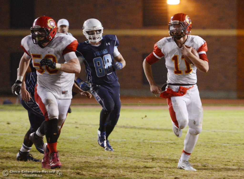 . Chico High\'s #58 Malik Hopkins (left) blocks for #11 Clayton Welch (right) who runs against Pleasant Valley High\'s #88 Jack Suttles (center) in the second quarter of their Almond Bowl football game at CSUC University Stadium Friday, November 1, 2013 in Chico, Calif.  (Jason Halley/Chico Enterprise-Record)
