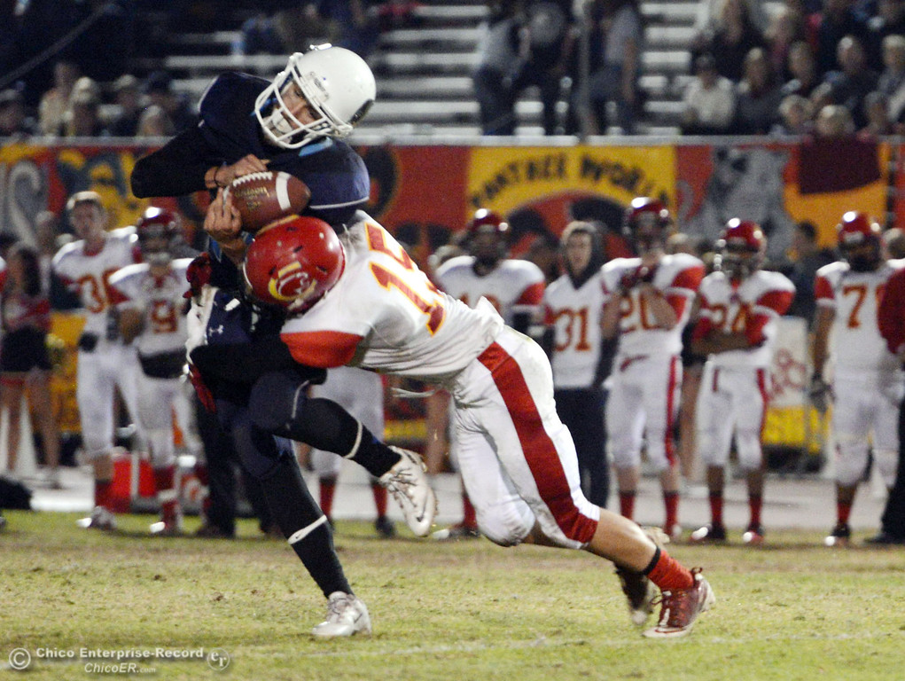 . Chico High\'s #15 Miles Fishback (right) tackles against Pleasant Valley High\'s #24 Jack Soza on a catch in the second quarter of their Almond Bowl football game at CSUC University Stadium Friday, November 1, 2013 in Chico, Calif.  (Jason Halley/Chico Enterprise-Record)
