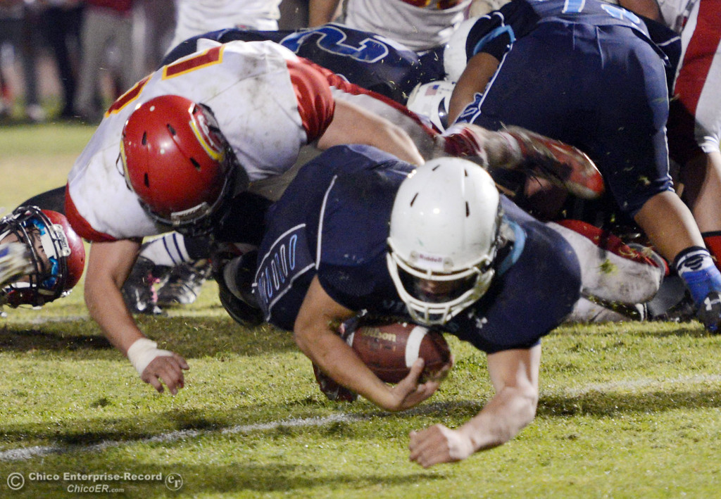 . Pleasant Valley High\'s #9 Houston McGowan (right) is tackled in the end zone for a touchdown against Chico High\'s #52 Chad Farrell (left) in the third quarter of their Almond Bowl football game at CSUC University Stadium Friday, November 1, 2013 in Chico, Calif.  (Jason Halley/Chico Enterprise-Record)