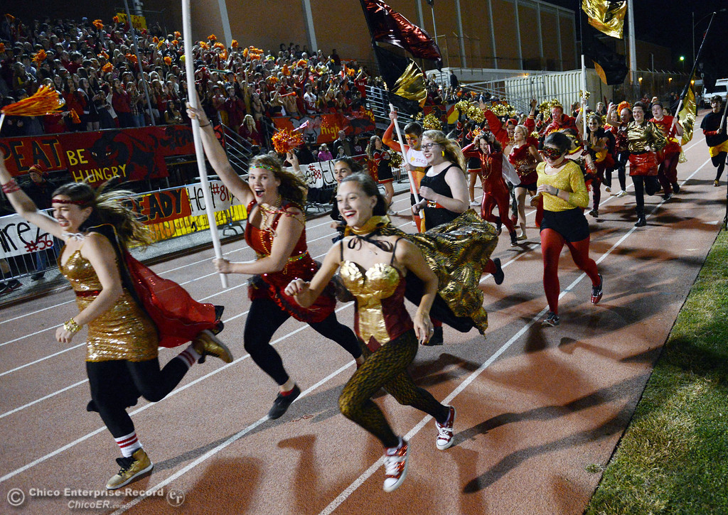 . Chico High race down the track to cheer on against Pleasant Valley High in the first quarter of their Almond Bowl football game at CSUC University Stadium Friday, November 1, 2013 in Chico, Calif.  (Jason Halley/Chico Enterprise-Record)