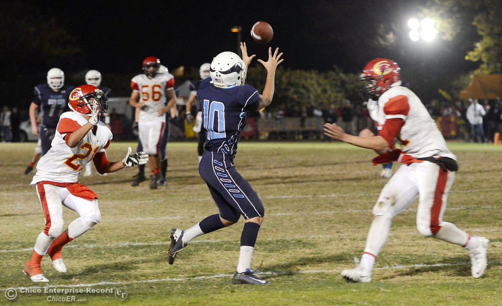 . Pleasant Valley High\'s #10 Tucker LaRue (center) attempts a catch against Chico High\'s #21 Cameron Alfaro (left) and #11 Clayton Welch (right) in the second quarter of their Almond Bowl football game at CSUC University Stadium Friday, November 1, 2013 in Chico, Calif.  (Jason Halley/Chico Enterprise-Record)