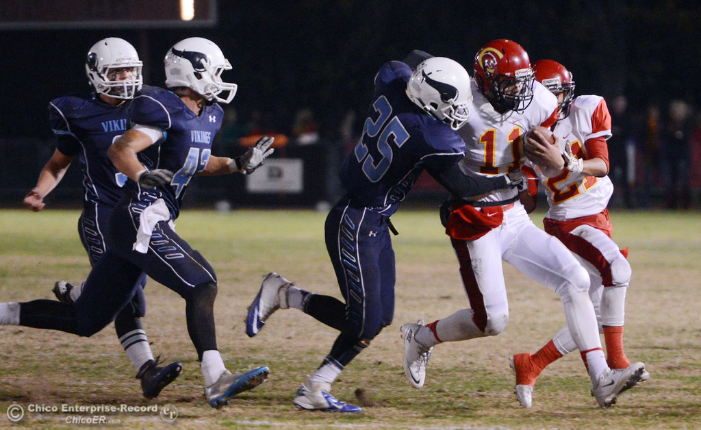 . Chico High\'s #11 Clayton Welch (right) is tackled against Pleasant Valley High\'s #25 Ryan Steindorf (left) in the first quarter of their Almond Bowl football game at CSUC University Stadium Friday, November 1, 2013 in Chico, Calif.  (Jason Halley/Chico Enterprise-Record)